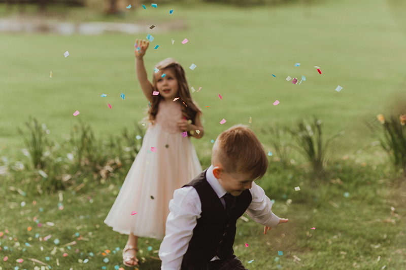 kids playing with confetti