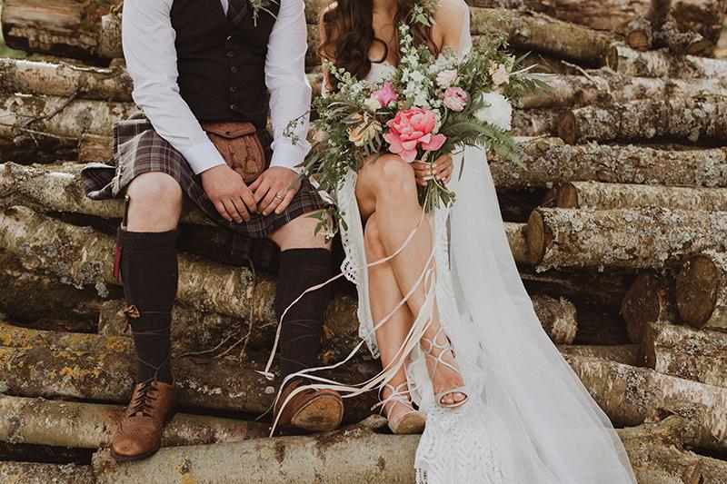 Wedding Couple sitting on logs