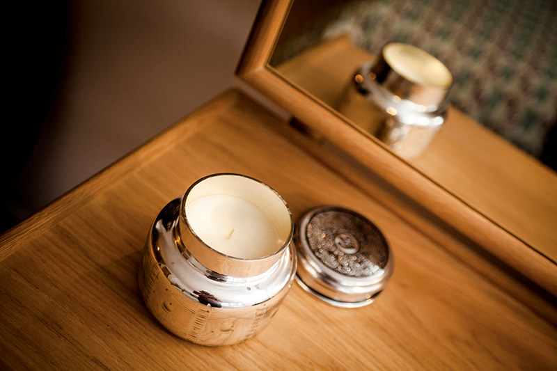 Candle on an oak dressing table