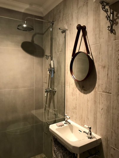 Tiled Bathroom with modern mirror